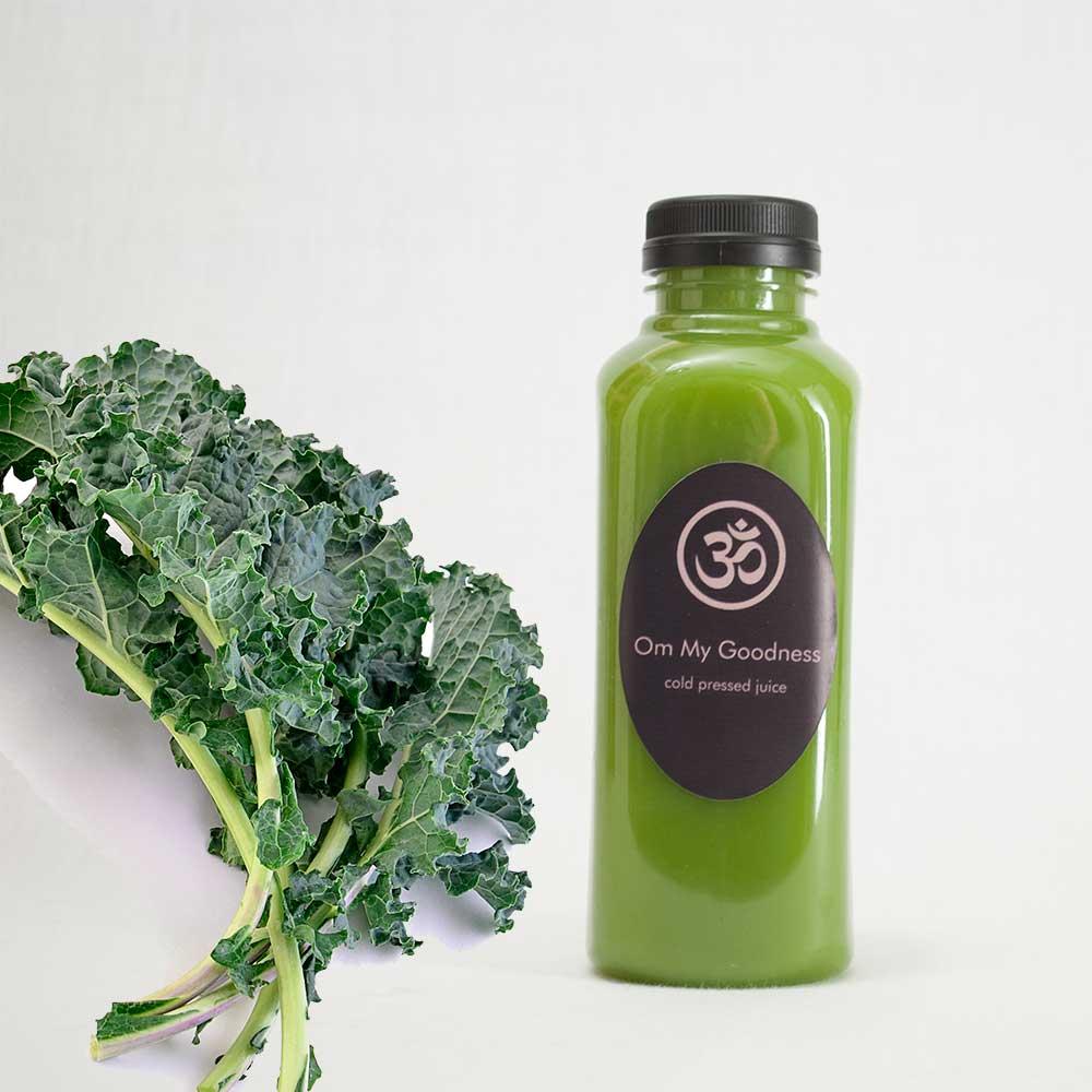 Green juice next to some organic kale